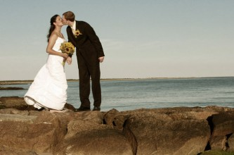 Bridal ouple kissing at beach