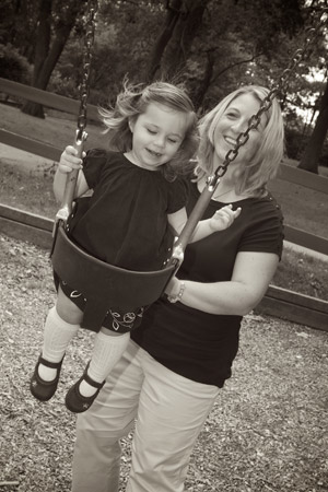 mother with daughter on swing