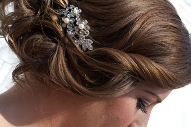 bride's hairstyle with rhinestone hair comb