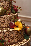 lace frosting on wedding cake with fresh flowers