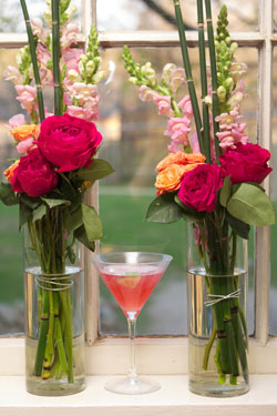 cosmo cocktail with bouquets in flower vases