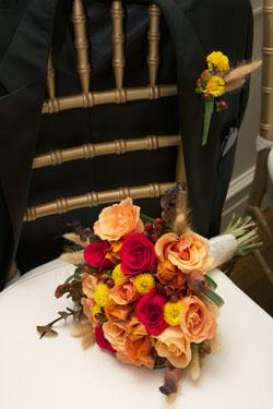 groom's tux coat with bride's bouquet