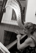 harpist playing during wedding reception