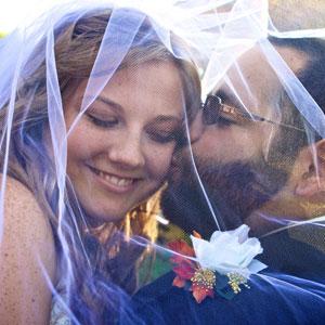 under veil wedding couple