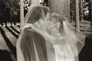 wedding kiss bride groom veil