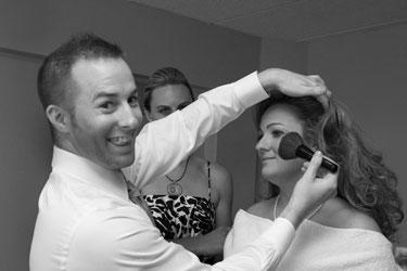 Stylist applying blush to bride
