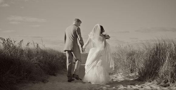 wedding bride groom walking beach